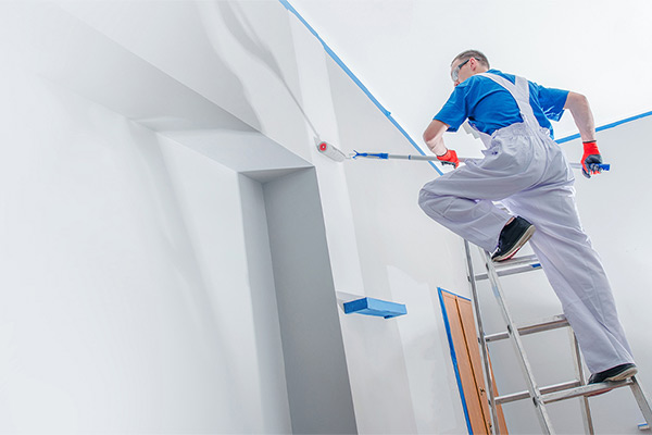 Man painting the interior of a business