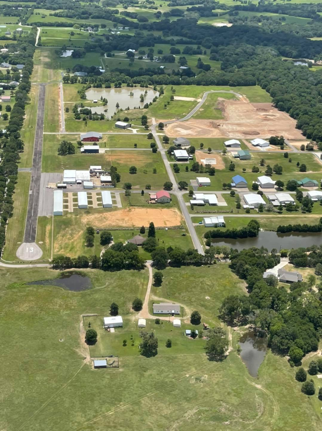 Aerial view of construction on new lots in Section II of the Hangar Homes area at Tailwind Airpark