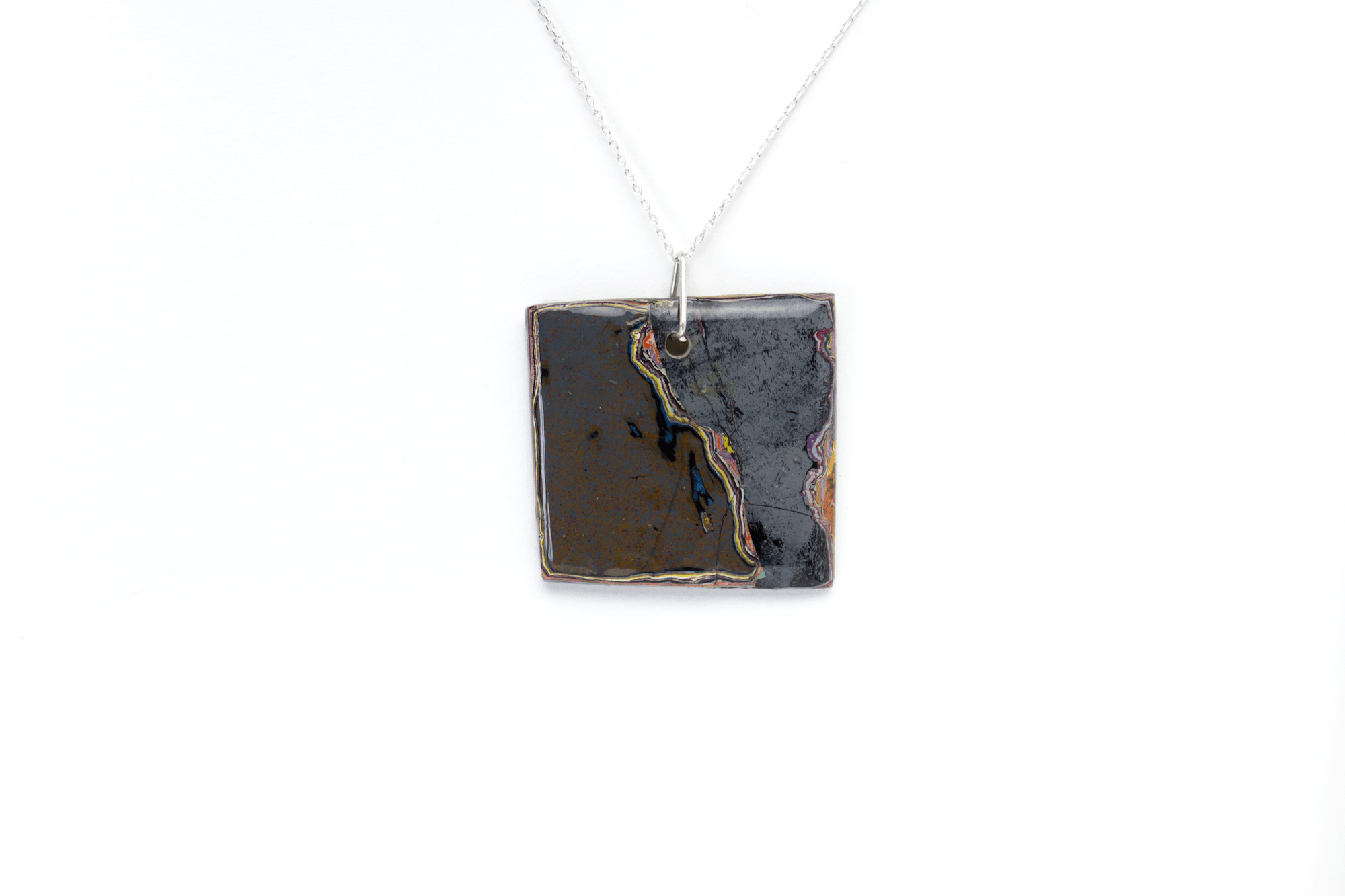 Unique graffiti stone pendant on sterling silver chain.