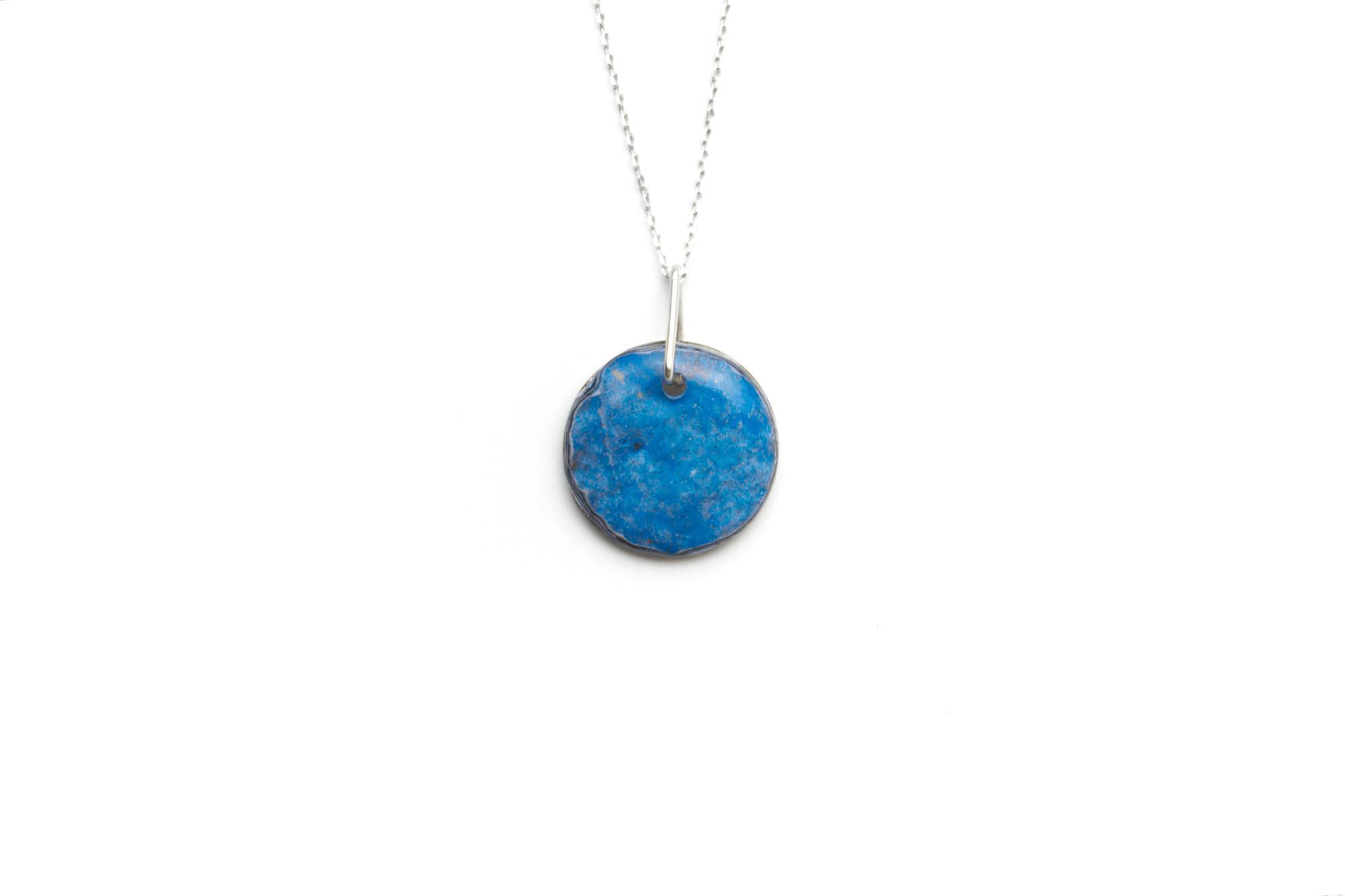 Unique graffiti stone pendant on sterling silver chain.