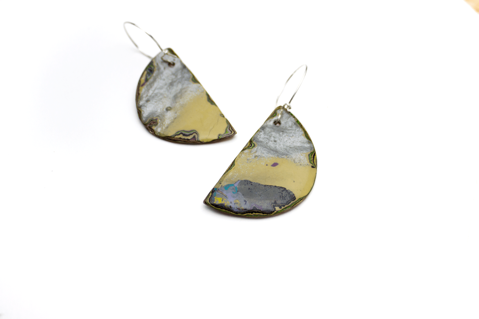 Unique, double-sided statement earrings.