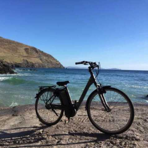 View of an electric bike with Slea Head in the background - one of the fun things to do in Dingle on a sunny day
