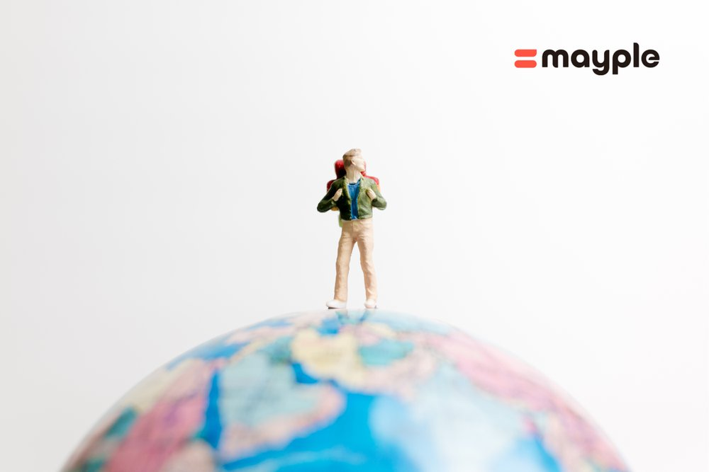 A miniature man waling on the globe