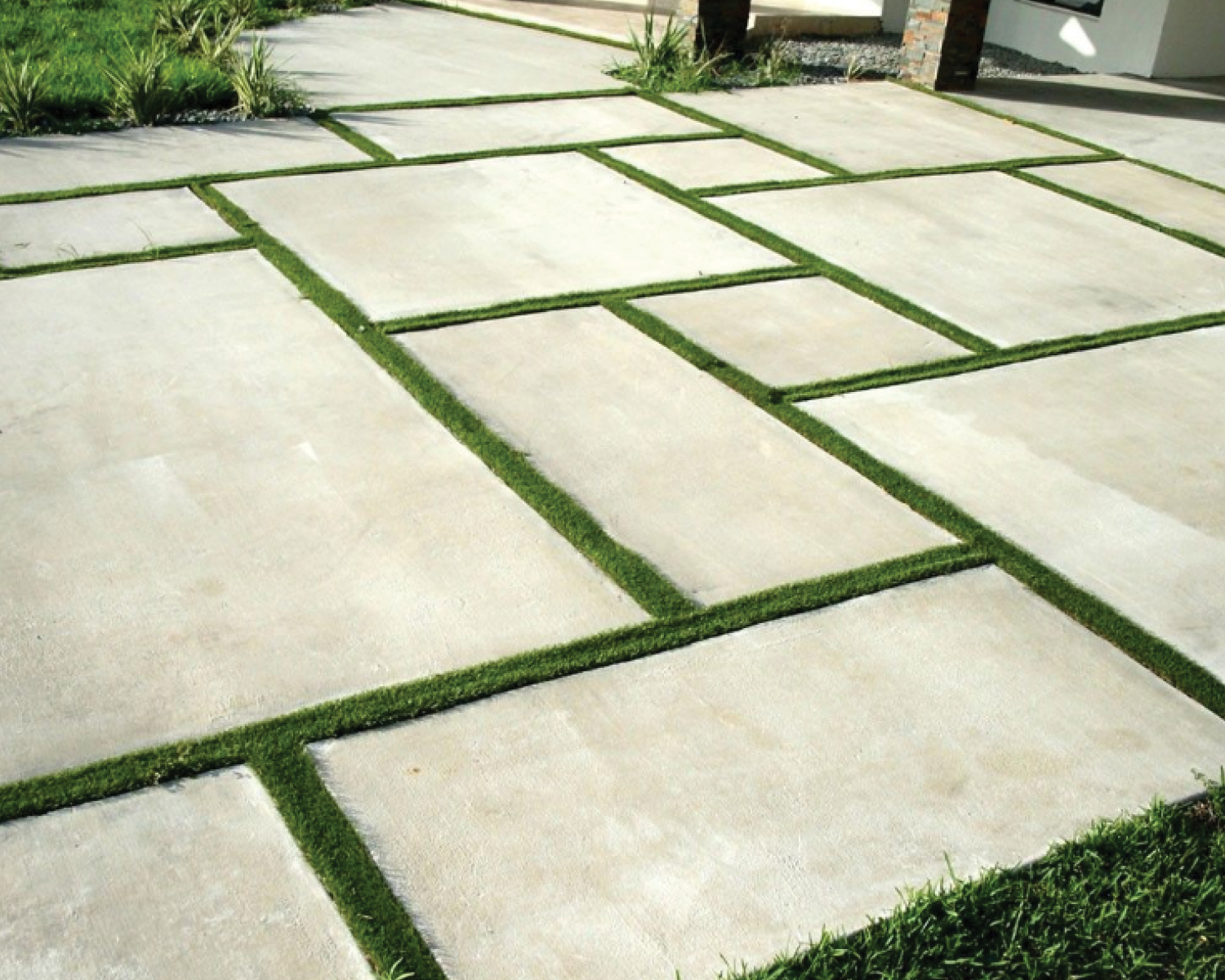 poured-concrete-pavers-with-grass