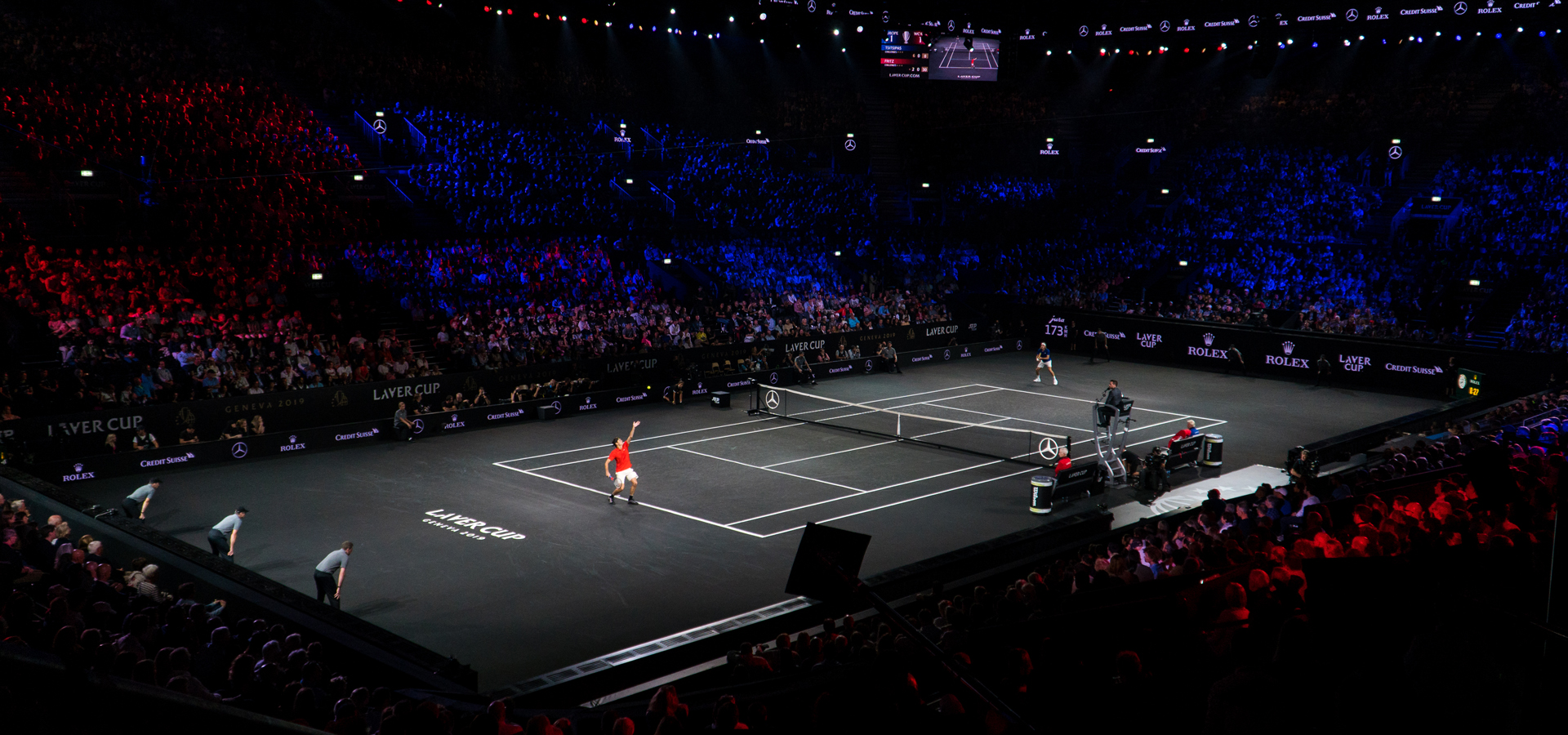 Laver Cup tennis match serve in the arena with dark lighting
