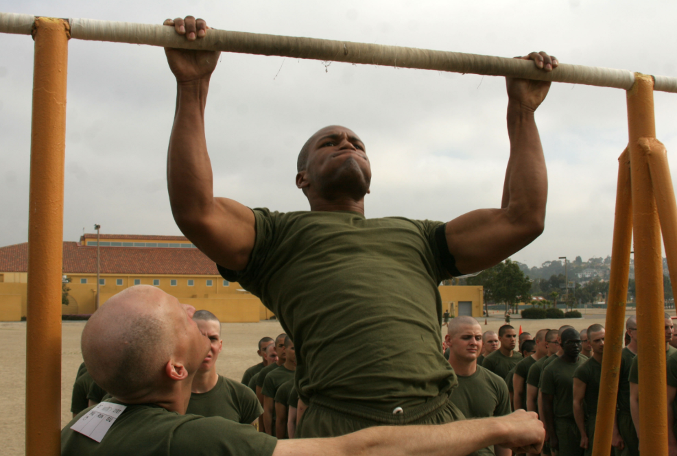 military recruit performing pull up