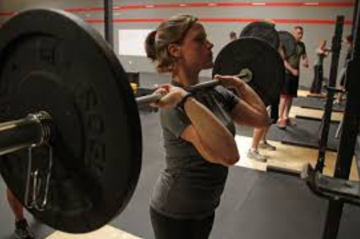 woman doing front squat in gym