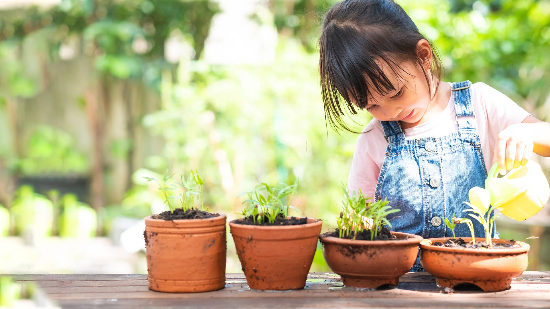 Girl watering plants in a Kindergarten