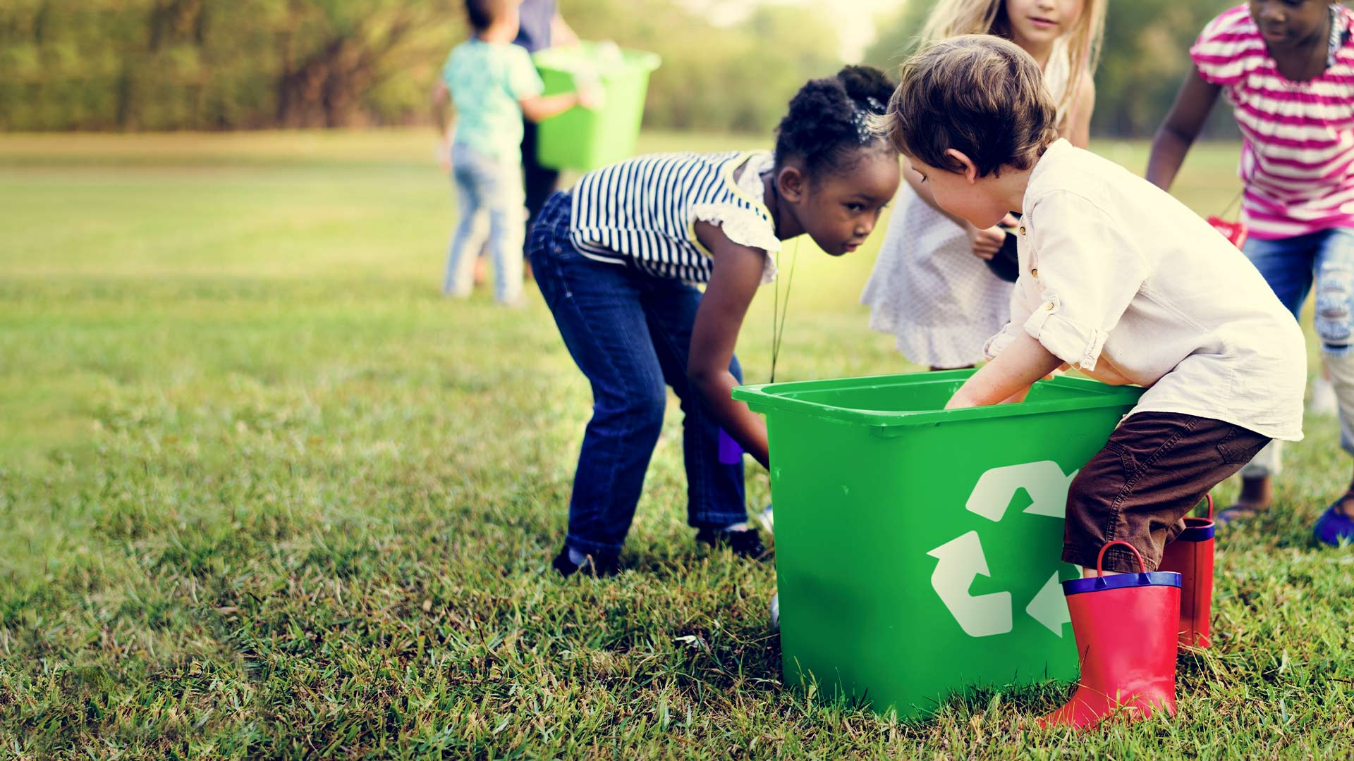 kids volunteering picking up trash and recycling