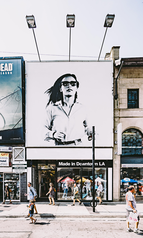 "<img alt=""billboard of girl running above American Apparel in downtown LA"">"