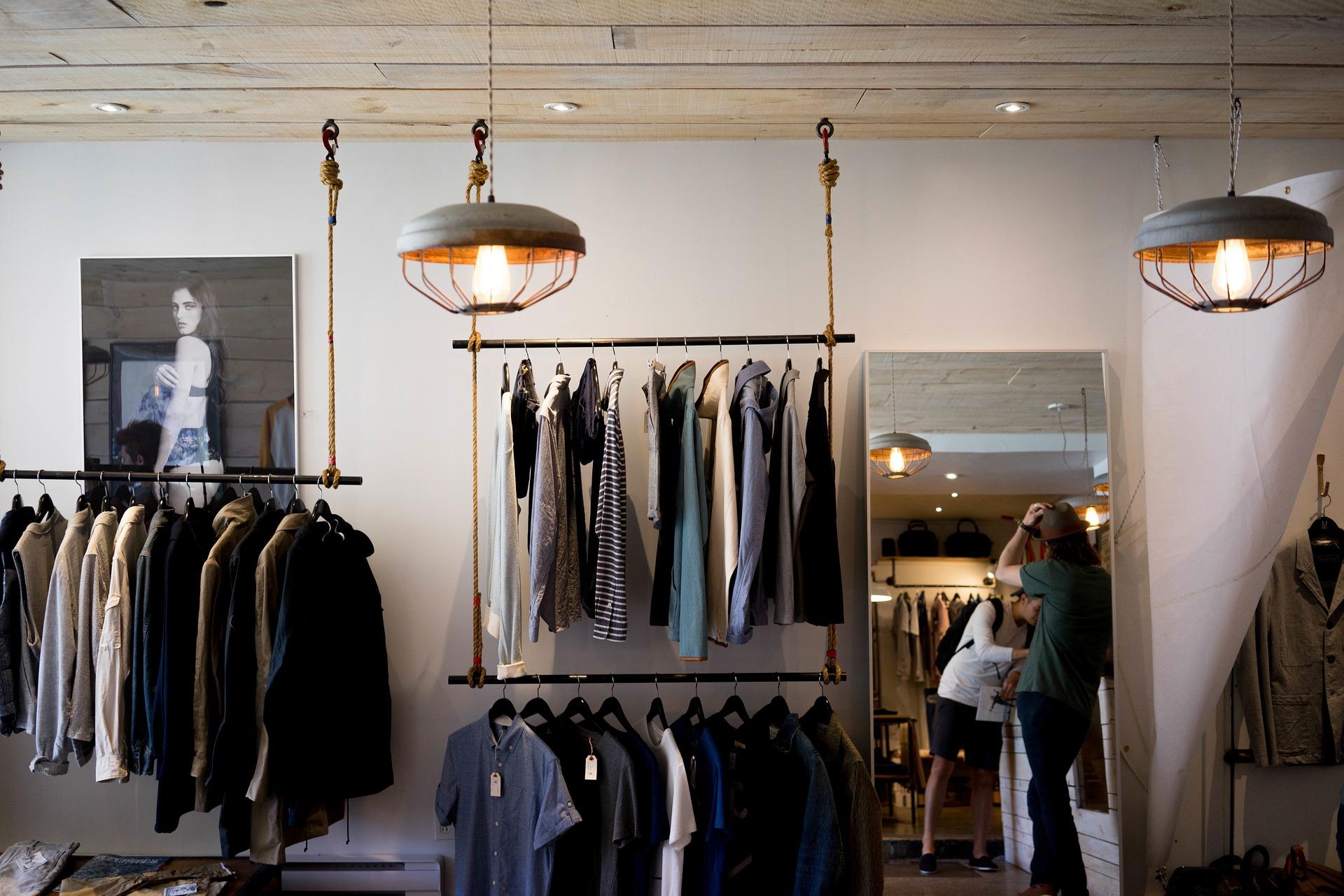 "<img alt=""warm dim-lit lighting inside a men's clothing store"">"