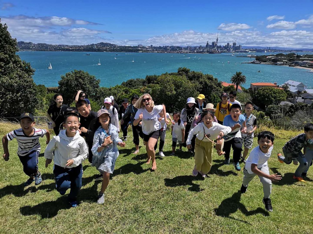 OutBeyond Study Tours in Auckland, New Zealand | Students enjoying the sunshine on their education program
