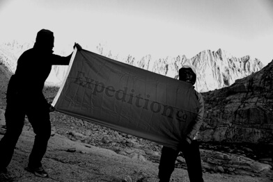 Software engineer, Eddie Yao holding the Expedition Co flag