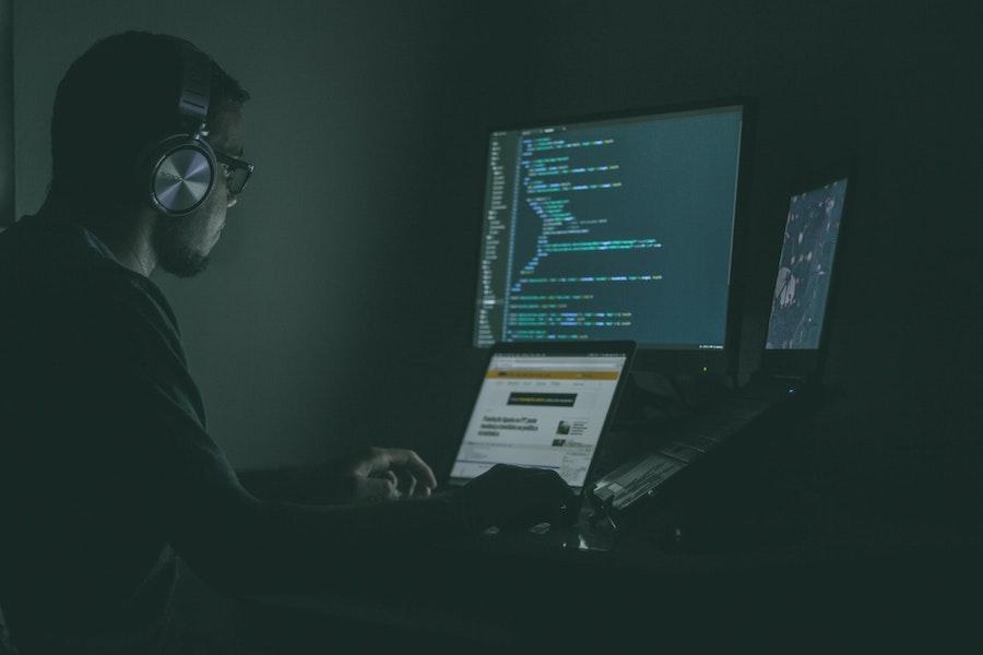 Back-end web developer writing code