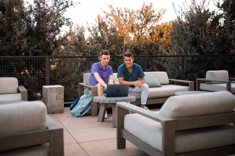 Tech entrepreneurs discussing mobile app