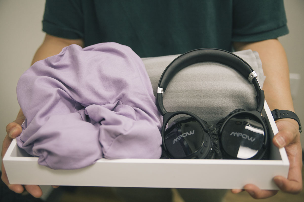 Closeup of headphones and a blanket