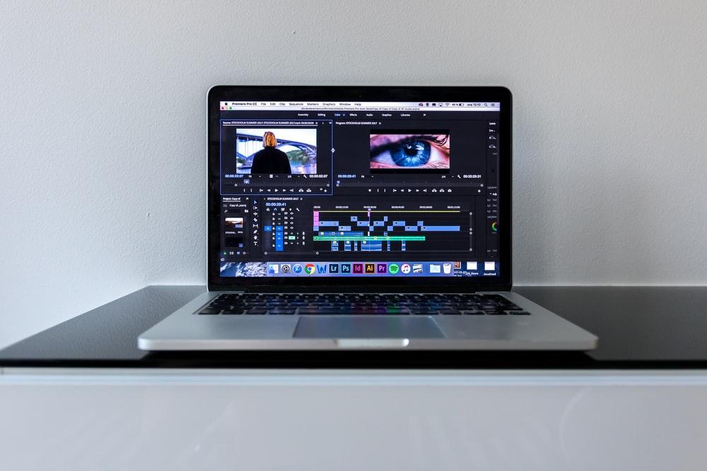 MacBook Pro on black desk