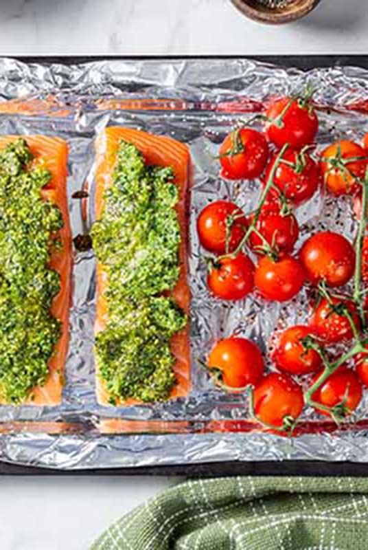 Salmon and cherry tomatoes on a sheet tray.