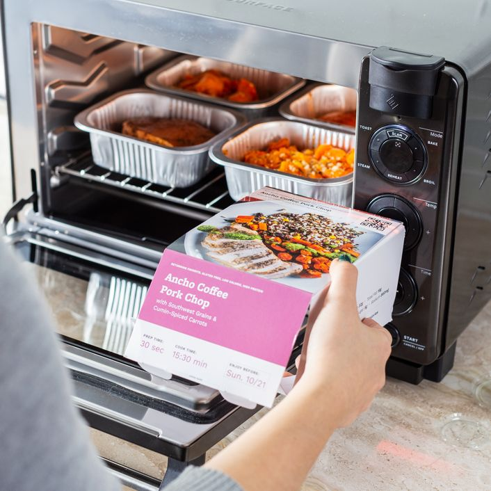 Person scanning barcode of Tovala Meal on the steam oven.