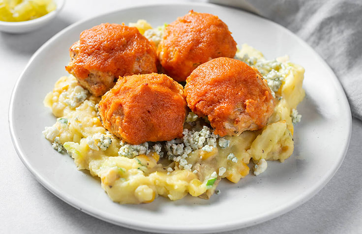Buffalo Chicken Meatballs with Loaded Smashed Potatoes.