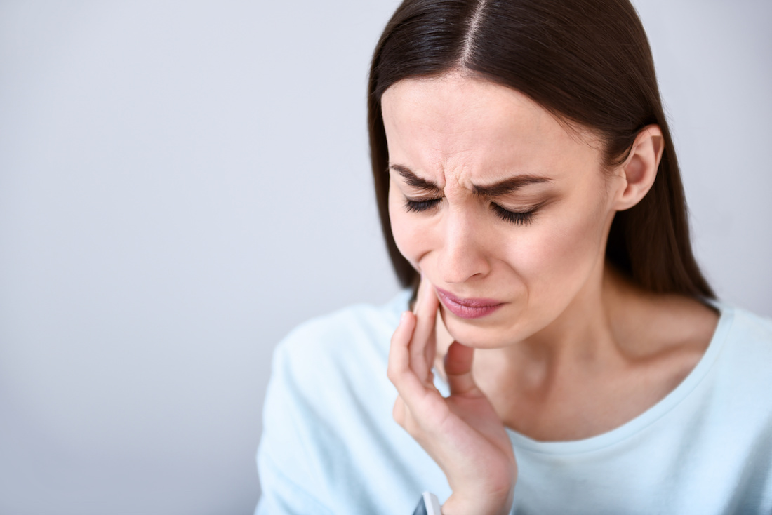 Woman clenching jaw in pain