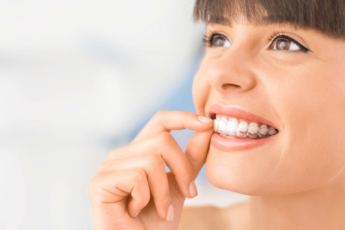 Patient using invisalign treatment