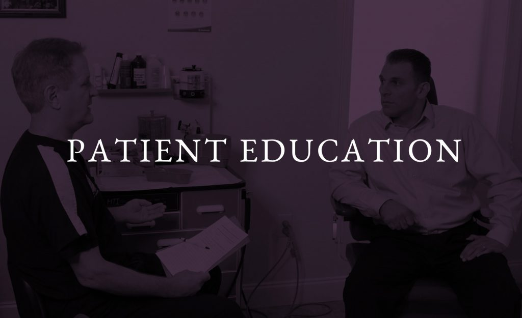 Dr Riesberg discussing his exam with a patient.