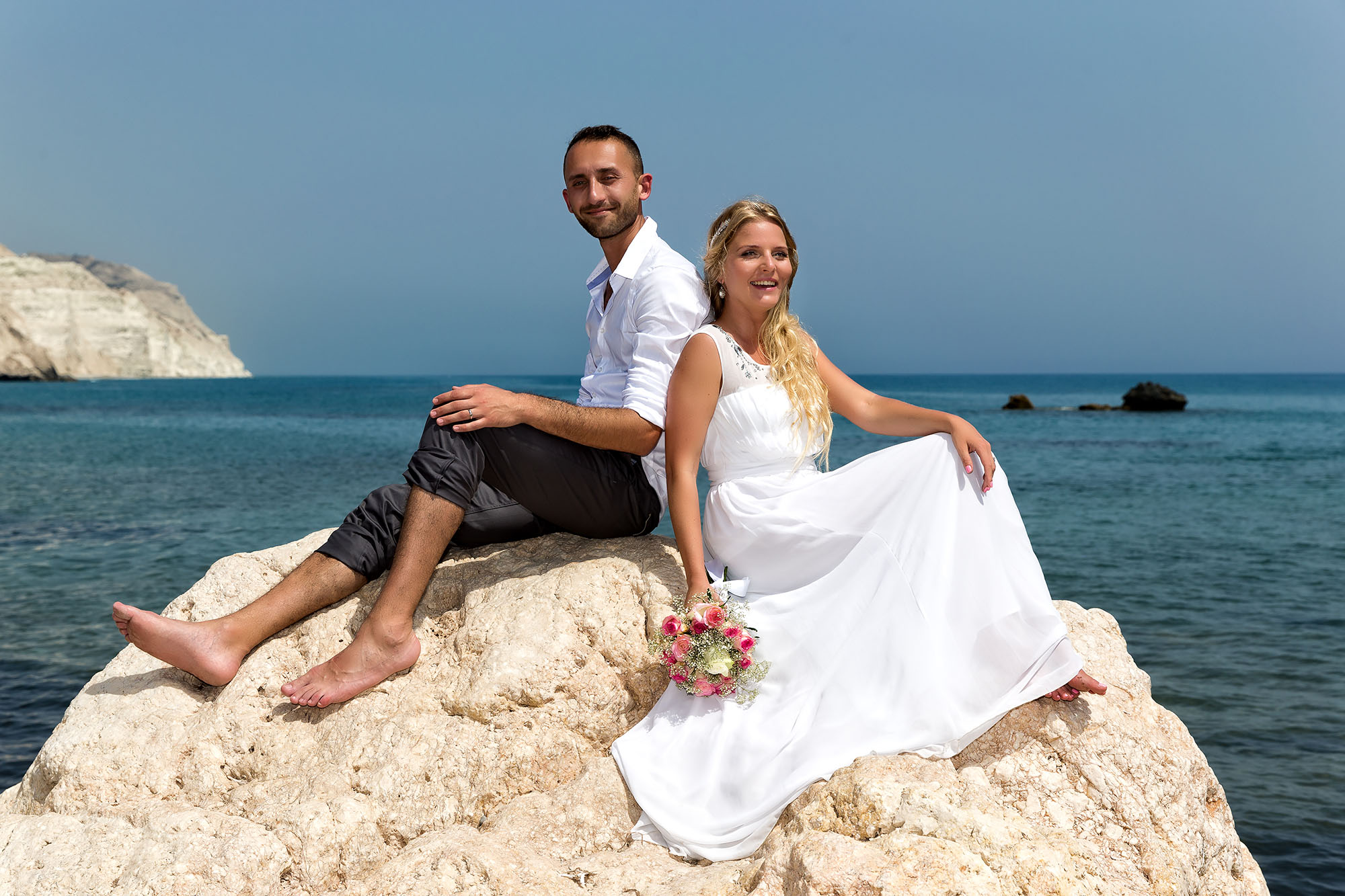 Romantic wedding photos taken at Aphrodite's Rock
