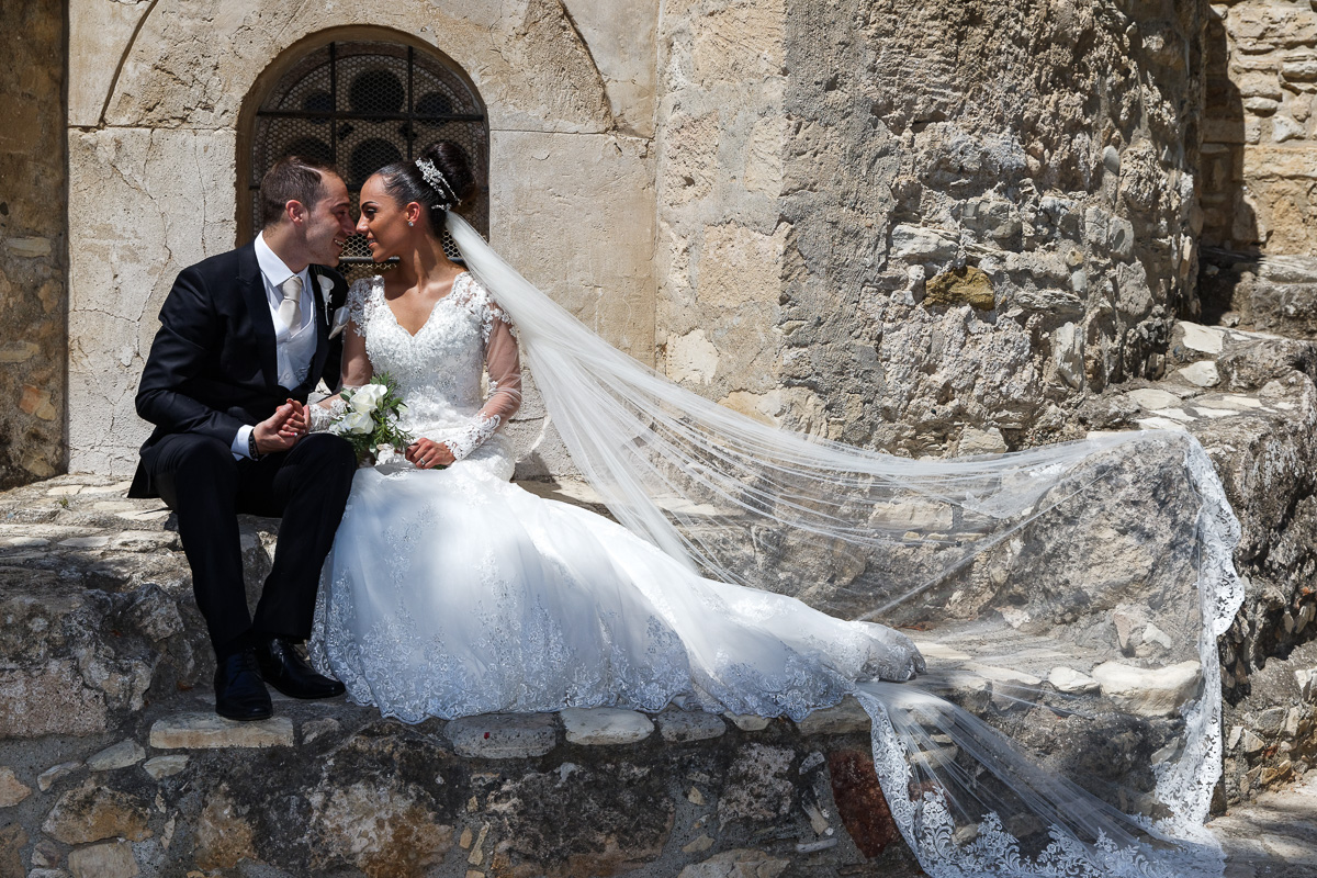 portrait of bride and groom outside the church