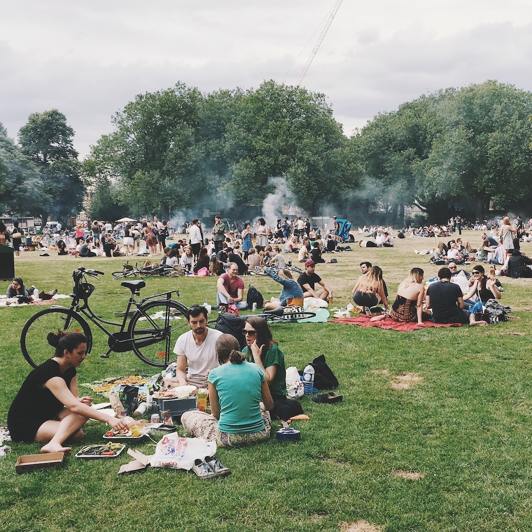 Photo of a park filled with people
