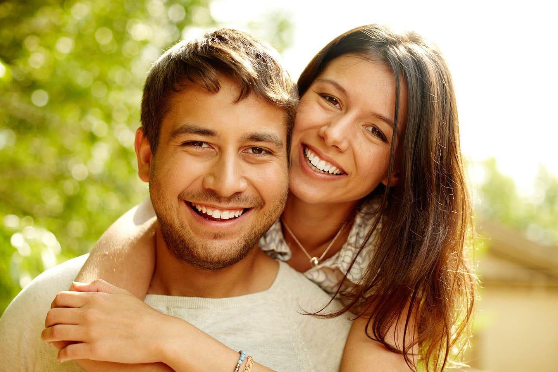 A couple lovingly embracing