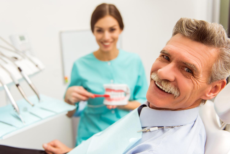 Dentist telling patient about dental bonding process