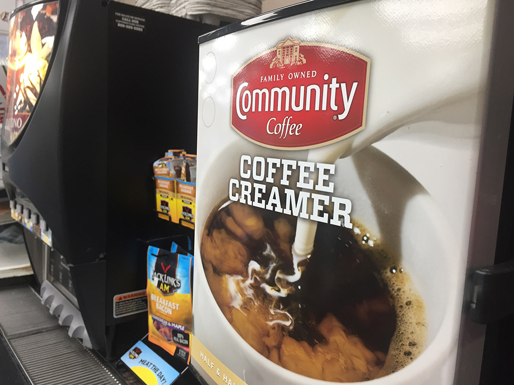 POINT OF PURCHASE - COMMUNITY cream dispenser