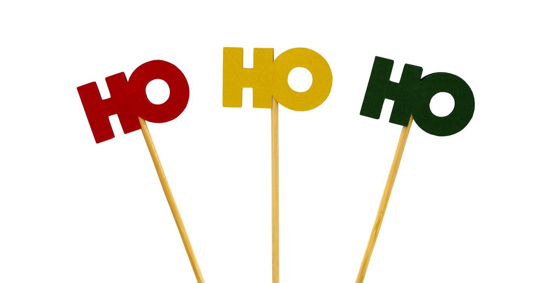 Wooden sticks holding the expression Ho Ho Ho