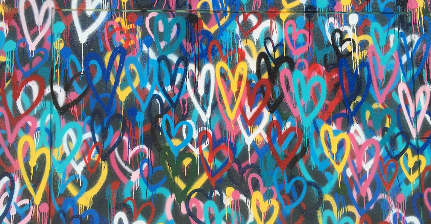 Lots of hearts hand painted on a wall