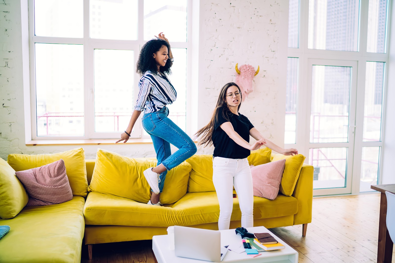 Virtual fundraiser: Two woman dance together in a living room