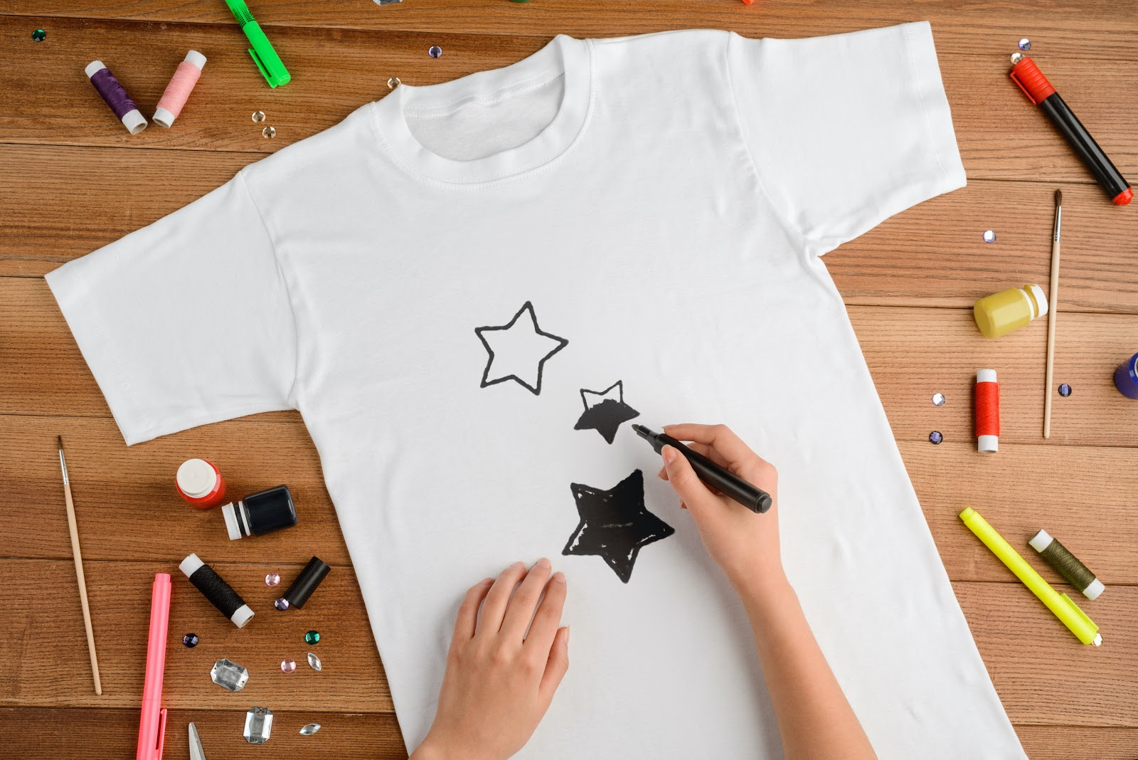 Person doodling on t-shirt