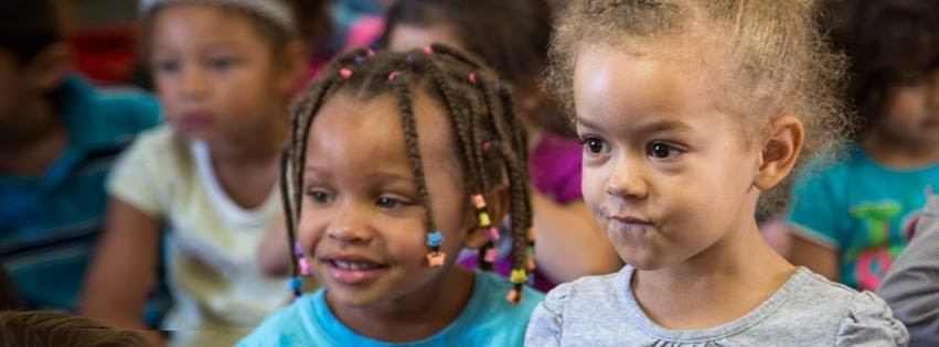 corporate philanthropy: Two female toddlers smiling