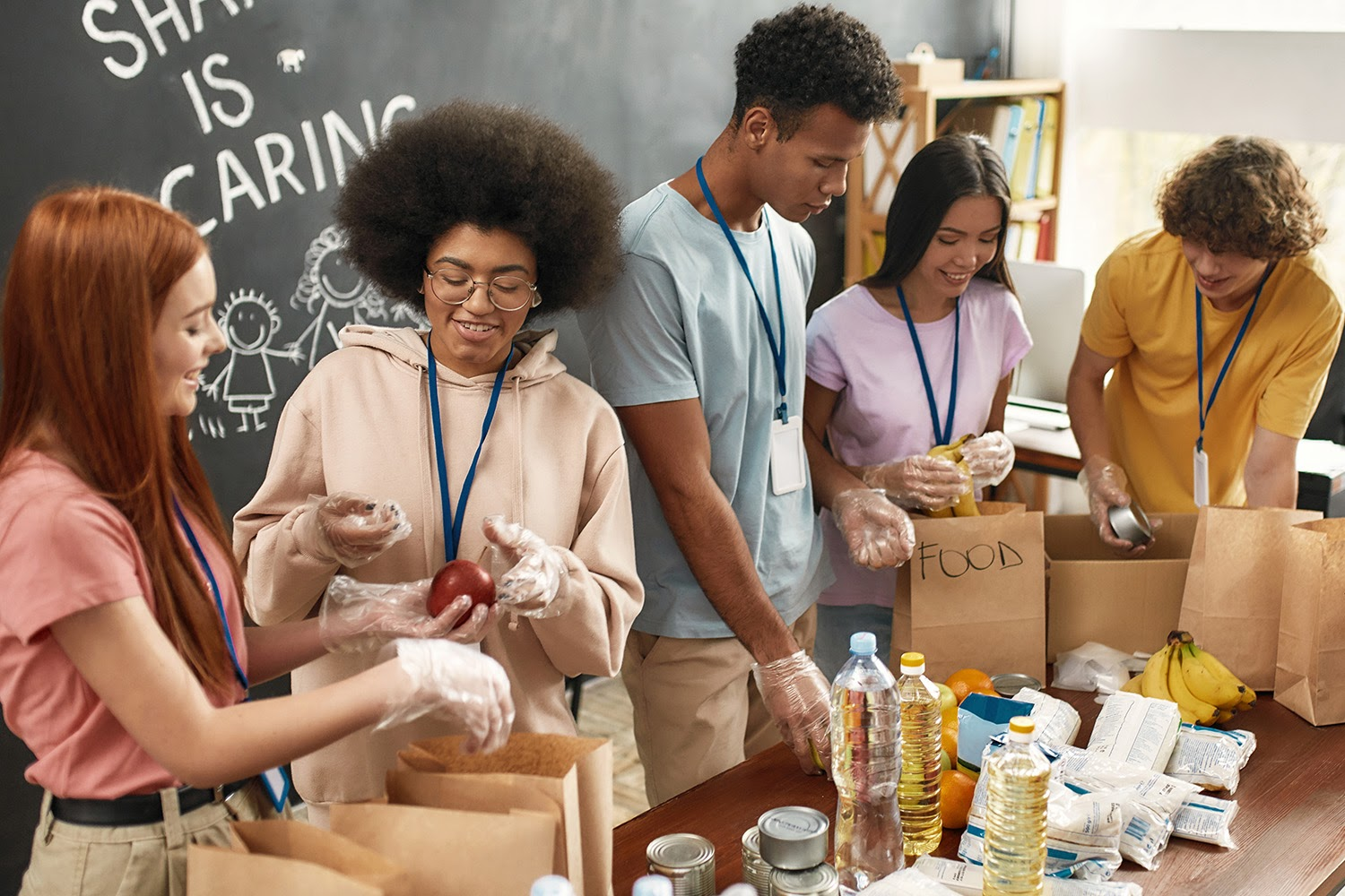 GoFundMe charity: Group of young people sorting food in paper bags