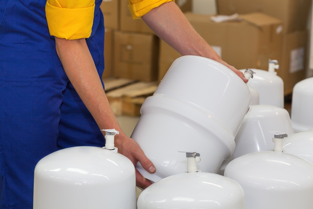 Factory worker holding a pressure vessel ready to be sold.jpeg