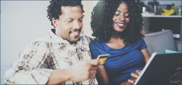 couple holding secured credit card