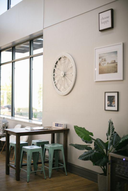 clock and framed photos