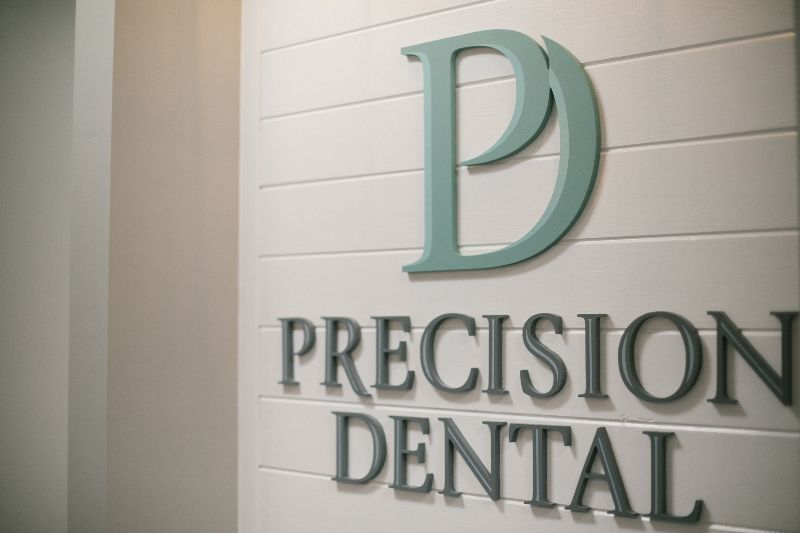 Close up on Precision Dental sign