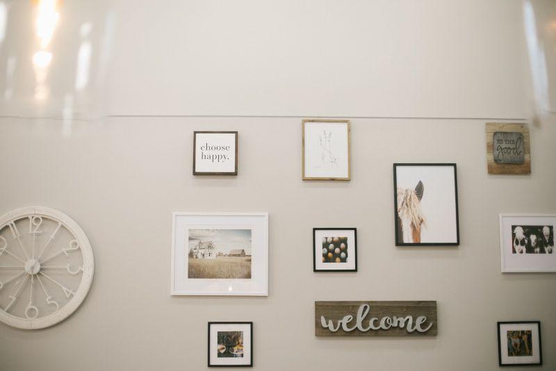 Wall of framed photos