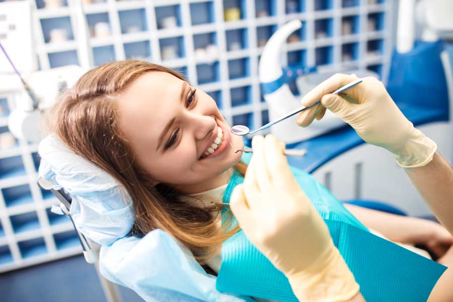 Woman smiling at the dentist