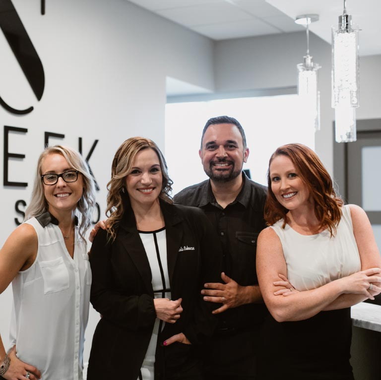 Photo of Dr. Paola with the Sleek Smile Studio team