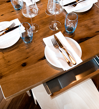 table setting with cutlery, napkins, glassware and crockery