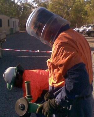 Worker wearing homemade head gear