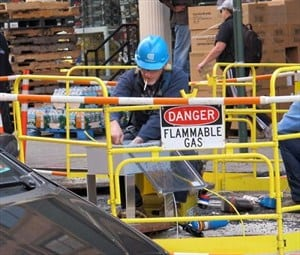 Man working around flammable gas while smoking a cigarette
