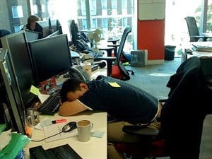 Man with a hangover sleeping on his desk